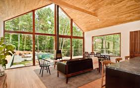 Floor To Ceiling Window A Humble Yet Extraordinary Retreat Hidden Amidst Forests And Meadows