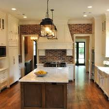 Cream Shaker Kitchen Cabinets by Exposed Brick Wall Contemporary Kitchen Madison Taylor Design