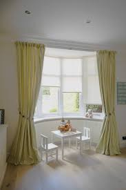 Curtains For Bay Window Yellow Curtains In The Window And Two Chairs And One Table Bay