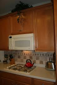 granite countertop olive kitchen cabinets metal backsplash tiles