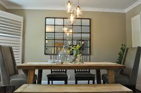 hanging light fixtures over dining table and kitchen island