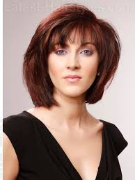 brunette hairstyle with lots of hilights for over 50 layered brunette bob with red highlights color me pretty hair