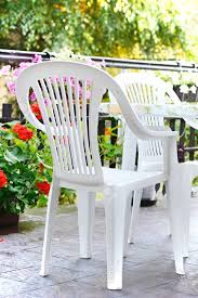 Outdoor Plastic Chairs White Plastic Chairs And Table On The Terrace In The Garden Stock