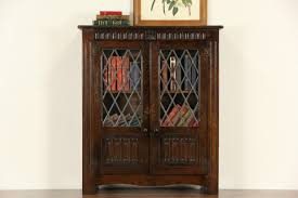 antique bookcase glass doors sold english tudor carved oak 1915 antique bookcase leaded