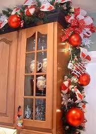 christmas decorations for kitchen cabinets perfect for christmas above the cupboard decor except i d have to