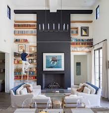 custom built in bookshelves with rolling ladders custom home