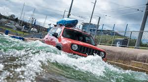 water jeep jeep renegade drives through olympic white water rafting course