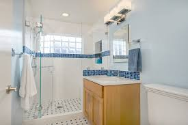 blue and white bathroom with glass block traditional bathroom