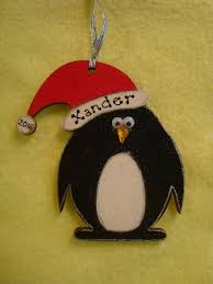 personalised wooden penguin in santa hat shaped christmas tree