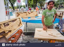 vancouver canada 9th jul 2017 wood carvers booth at car free