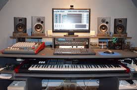 keyboard is nicely put under the table cool recording studio