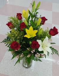 roses and lilies lilies and roses beautiful flowers in a vas3e
