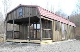 getaway cabins pine creek structures custom board n batten dutch cabin with porch sliding doors loft