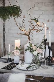 tree branch centerpiece 13 scandinavian inspired ideas for a cozy winter wedding winter