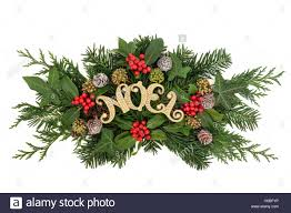 christmas decoration with noel glitter sign holly snow covered