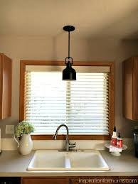 Sink Lighting Kitchen Updating The Kitchen With New Lighting Inspiration For Moms
