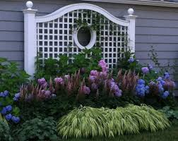 walpole trellis on a shady garage wall perfect for hydrangea