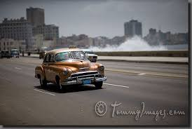 stock photos pictures a classic chevrolet drives along el malecon