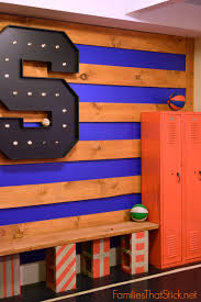 boy s basketball room reveal families that stick we used 12x12x1 pine boards stained them with cabot stain in bark mulch and nailed them into the wall the giant s was found at hobby lobby