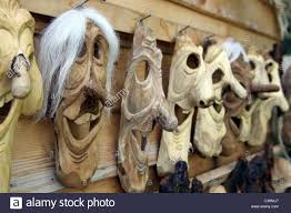 wooden carved masks for sale in bran transylvania romania they