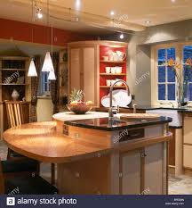 pendulum lighting in kitchen pendant lighting above breakfast bar on island unit with integral