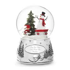 a wish child and snowman snow globe