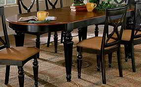 Heights Oval Dining Table Black Base With Cherry Top Finish - Black dining table with cherry top