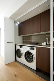 laundry area with frosty carrina countertops by freedom kitchens