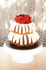 simple iced bundt cake with a red floral topper photo by aaron
