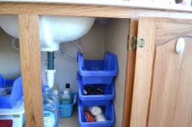the 15 smartest storage hacks for under your sink hometalk stack deep bins against one wall