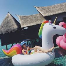 make your pool time magical with this inflatable unicorn raft