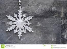 generic machine made christmas snowflake ornament on rustic styl