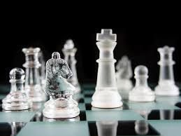 glass chess pieces on a frosted glass chess board chess g