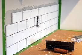 how to put up kitchen backsplash installing subway tile home tiles