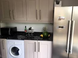 Wall Mount Heat And Air Unit Granite Countertop Cream Kitchen Wooden Worktops Maytag Over The