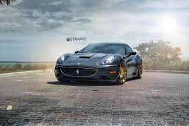 ferrari gold and black black ferrari california matches up with gloss bronze wheels
