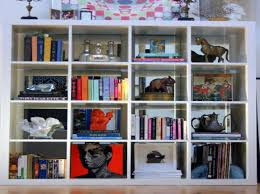 organizing a small apartment with white book shelves home