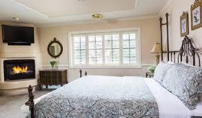 deluxe king guestroom with fireplace coachman u0027s inn carmel