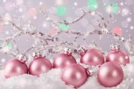 pastel pink colored ornaments on snow stock photo picture and