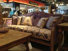 with the aztec patterned seat cushion and buttons the wright sofa