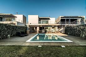 modern luxury house with pool in portugal by dunaplana storify