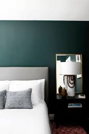 minimalist bedroom with dark green walls gorgeous paint color