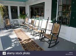 Patio Rocking Chairs Wood Many Wood And Wicker Rocking Chairs On A Large Outdoor Front Porch