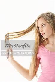 long hair on 66 year old girl brushing hair stock photo masterfile premium royalty free