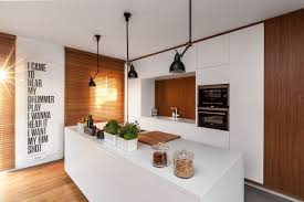 white house family kitchen small house harmonizes functions through simplicity