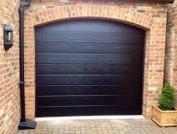 alutech sectional garage door design choices jd uk black m rib sectional garage door