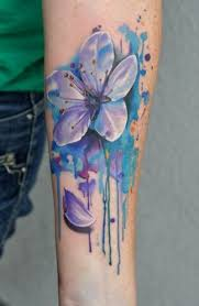 super 3d realistic colorful flower tattoo on arm in watercolor