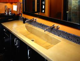 cream concrete sink over black wooden vanity plus double steel