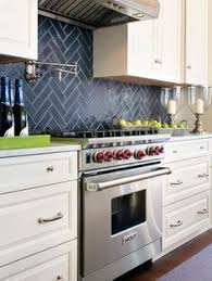 Blue Tile Kitchen Backsplash - white and blue kitchen features white shaker cabinets paired with