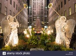 the christmas tree at rockefeller center and angels at night stock